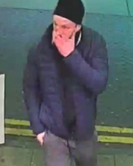 An image of the man, wearing a black beanie, blue coat and grey jogging bottoms, who police wish to