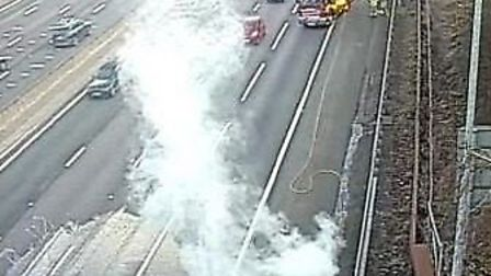 The M25 this afternoon. The car on fire is shown on the bottom left with a fire engine in the top ri