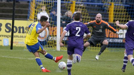 Zane Banton fires the ball towards goal only to see Lukas Lidakevicius pull off a fine save. Picture