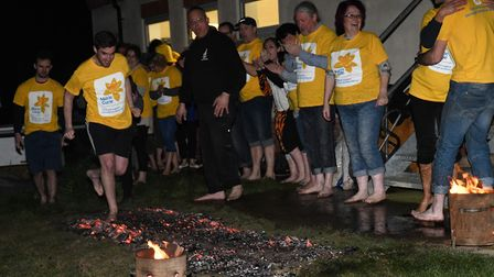 A fundraising fire walk took place at St Ives Rugby Club. Picture: ARCHANT