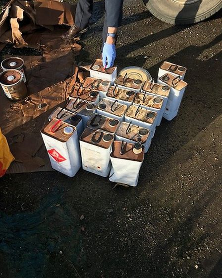 A collection of oil canisters that have been dumped by fly tippers.