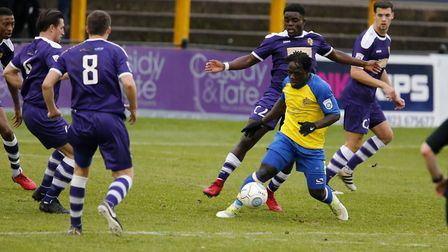 Solomon Sambou battles to keep hold of the ball against East Thurrock. Picture: LEIGH PAGE