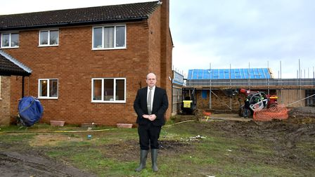 Chris May pictured on the site of the new care facility in Upton.