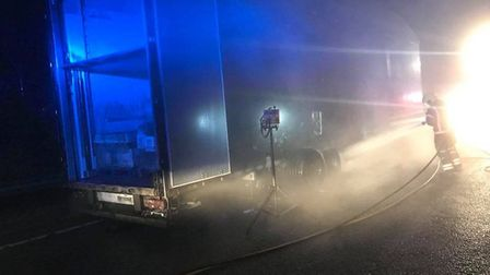 Firefighters tackling a burning lorry at Godmanchester