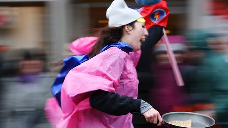 Teams compete in the St Albans pancake race 2018. Picture: Danny Loo