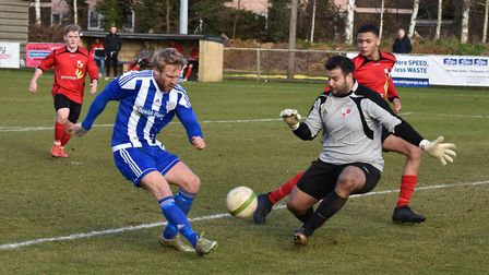 Eynesbury Rovers' striker Craig Smith is denied during their home clash against Sileby Rangers. Pict