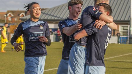 St Neots Town players celebrate their goal rom Tom Wood (right) against Tiverton. Picture: CLAIRE HO