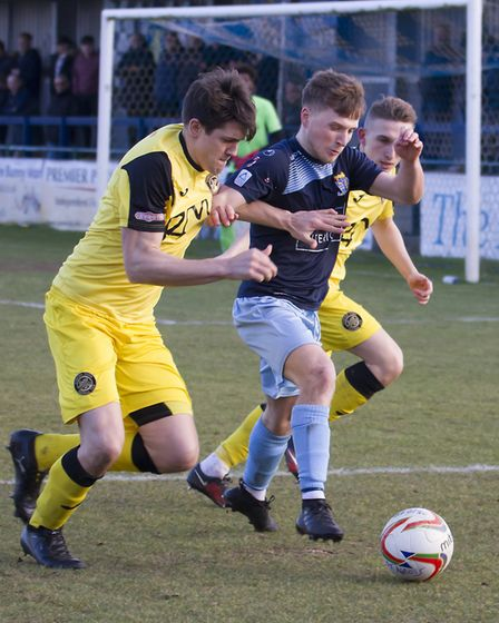 St Neots Town man Stefan Broccoli receives attention from two Tiverton players. Picture: CLAIRE HOWE