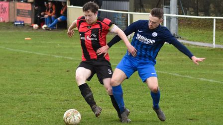 Defender James Seymour battles for the ball during Huntingdon Town's defeat against Lutterworth Town