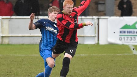 Huntingdon Town midfielder Ben Panting battles for the ball against Lutterworth Town. Picture: J BIG
