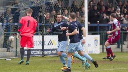 Johnny Herd celebrates after putting St Neots Town ahead from the penalty spot against Chesham. Pict