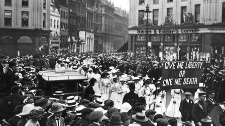 A memorial procession for the Suffragette, Emily Davison, passing through Shaftesbury Avenue (Photo