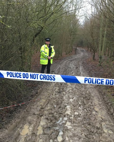 Police cordon close to the murder site at Hinchingbrooke Park