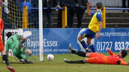 Ronnie Vint almost turns the ball into his own net as he tries to stop Sam Merson scoring. Picture: