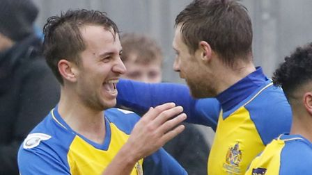 Sam Merson celebrates with captain David Noble after putting the Saints into a two-goal lead. Pictur