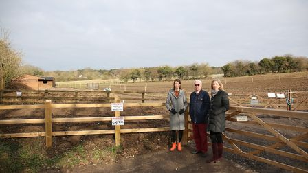 Beth Grant, Bryn Williams and Charlotte Vickerstaff in front of the stables and parking area which h