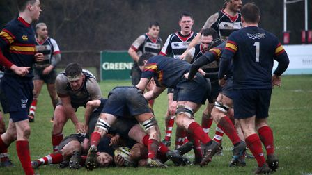 Tabard try to free the ball. Picture: Kevin Lines