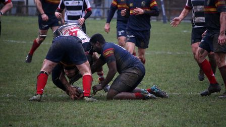 Tabard try to snatch the ball. Picture: Kevin Lines