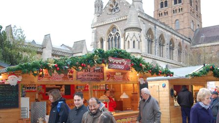 A photo of some of the chalets and visitors from the St Albans Christmas market, held in the Vintry