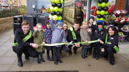 Pupils from Huntingdon Primary School cut the ribbon to declare the new Co-operative store open