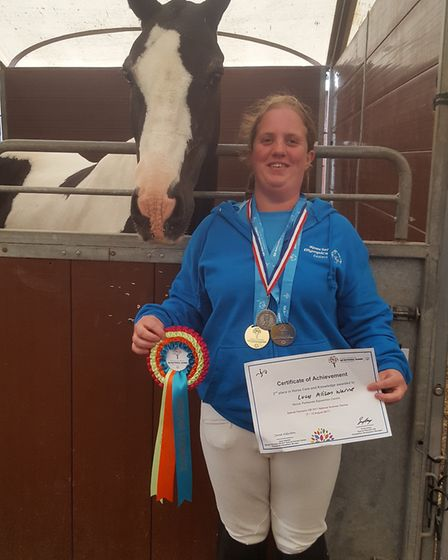 Lucy Warne with horse Finnigan after winning a gold and two silver medals at the Special Olympics na