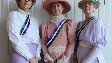 Victoria Collier, Jemma Macfadyen and Mary Loram in their suffrage campaign clothes. Picture: The Co