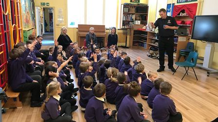 Therfield First School pupils getting fire safety advice from Ray Constant, who is the watch command