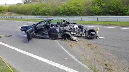 A BMW convertible after it rolled on the A505 between Baldock and Royston. Photo: Baldock fire stati