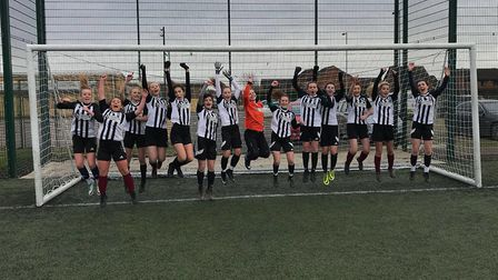 St Ivo School Under 16 Girls are jumping for joy.