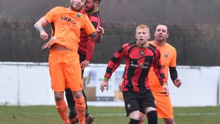 Chris Jones challenges for a header as Huntingdon Town team-mate Ben Panting looks on. Picture: J BI