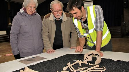 Cynthia and Brian Pepper with project officer Stuart Ladd explaining the history of the Bronze Age s