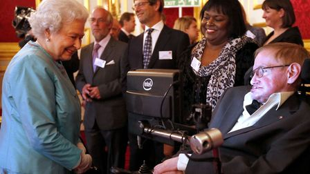 Queen Elizabeth II meeting Professor Stephen Hawking, who has died aged 76, during a reception for L