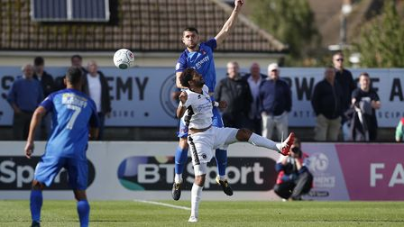 Jamie Sendles-White wins the ball in the air playing for Leyton Orient at Boreham Wood. Picture: SIM