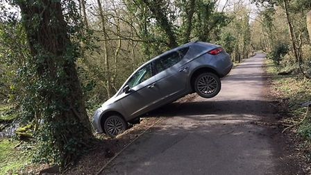 Man arrested after car goes of the Thicket path near St Ives