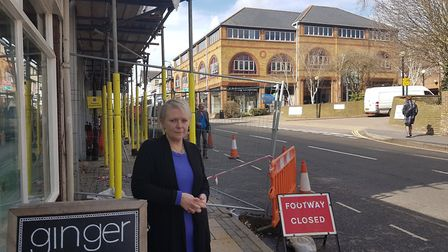 Suzie Vincent outside Ginger Natural Health on London Road with the development behind her and the e
