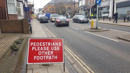 The sign blocking the pavement for the development on London Road.