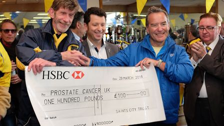 Chairman of Saints City trust Ian Rogers and St Albans City FC owner Lawrence Levy present a cheque