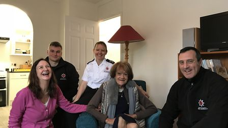 Sandra with nurse Di Walters and members of the fire service. Picture: Courtesy of Di Walters.