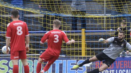 Connor Riley-Lowe sends Dean Snedker the wrong way from the penalty spot. Picture: BOB WALKLEY
