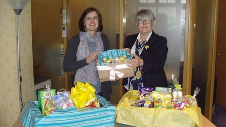Jackie Cotton from Home-Start receiving the eggs from Trudy Lambert of Cecil Newling at the end of a