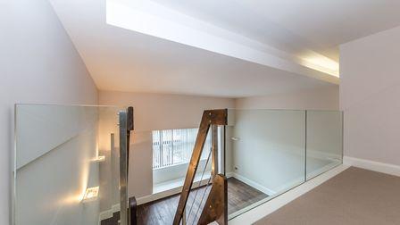 The mezzanine level gives the flat a New York apartment feel