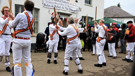 Morris dancers keeping warm at the festival. Picture: Clive Porter