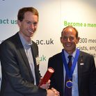 Royston scientist Dr Peter Charlton, pictured when receiving an award from Professor Mark Tooley for