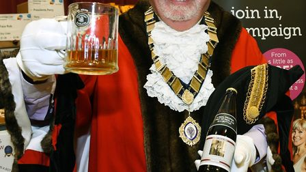 Mayor of St Neots Cllr Derek Giles tests a speciality ale at the Booze on the Ouse festival