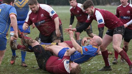 Tom Shelton is tackled by a Hitchin forward. Picture: Danny Loo