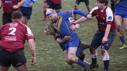 Darren Westhead is tackled against Hitchin. Picture: Danny Loo