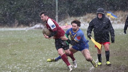 Adam Shaw is tackled into touch by Sam Perry. Picture: Danny Loo