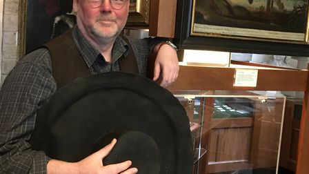 Stuart Orme, new curator and manager at the Cromwell Museum, with a replica of Cromwell's hat
