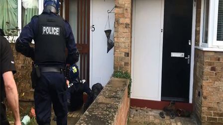 Police officers forced down the door of the property in Cambridge