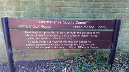 The sign near the gate, which shows there was once an agreement made for Richard Cox House to use th
